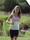 Girl Jogging with Headphones Posters