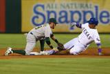 Sep 26, 2014: Arlington, TX - Oakland Athletics v Texas Rangers - Leonys Martin, Eric Sogard Photographic Print by Ronald Martinez