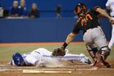 Baltimore Orioles v Toronto Blue Jays Photographic Print by Tom Szczerbowski