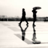 Two Men in Rain with their Reflections Photographic Print by Nadia Draoui