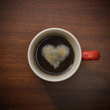 Coffee Cup with Crema Resembling a Heart Shape Photographic Print by David Malan