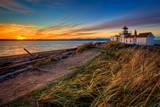 Phare au coucher du soleil Reproduction photographique par Photo by David R irons Jr