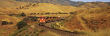 Freight Train Winding through Golden Hills Photographic Print by Timothy Hearsum
