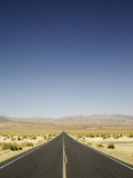 Long Road in Desert with Blue Sky. Photographic Print by Ryan Mcvay