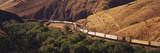 Two Freight Trains Passing in Narrow Canyon Photographic Print by Timothy Hearsum