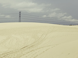 Pylon atop Sand Dune Photographic Print by Photograph by Chris Round