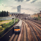 Metro Train Travelling on Railway to London City Photographic Print by Mark Jones Images