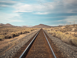 Train Tracks in the Desert. Photographic Print by  harpazo_hope