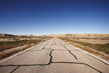 Cracked Desert Road Leading into the Distance Photographic Print by Gary Yeowell