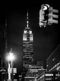 NYC Urban Street Scene - The Empire State Building at Night with a Red Light Photographic Print by Philippe Hugonnard