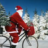 Father Christmas on Bicycle Cycling Past Fir Fotoprint van Ake Lindau and Johan De Meester