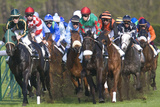 Riders and Racehorses Galloping around Racecourse Photographic Print