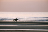 Horse Horseback Riding on Beach by Sunset Photographic Print