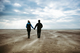 A Couple Together on a Winters Day on a Beach Photographic Print by Clive Nolan
