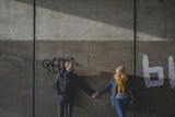 A Couple Holding Hands in an Underpass Photographic Print by Clive Nolan