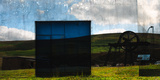 Conceptual Image of Building in Landscape Photographic Print by Clive Nolan