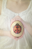 Egg with Ladybug in Woman Hands Photographic Print by Elizabeth Urqhurt