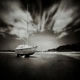 Sailing Boat on Sandy Shore Photographic Print by Steven Allsopp
