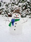 Snowman with Scarf and Hat in Winter Scene Photographic Print