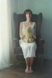 Stuffed Animal in Young Woman's Lap Photographic Print by Elizabeth Urqhurt