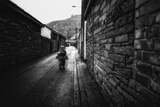Young Child Walking Down Street Photographic Print by Clive Nolan