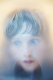Childs Face Behind Glass Photographic Print by Steve Allsopp