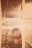 Child Behind Window Photographic Print by Steve Allsopp