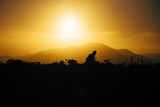 Photographer Trekking Through Sunset, Marin Headlands Photographic Print by Vincent James