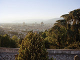 View through Trees of Florence Skyline at Sunset Photographic Print by Gary Yeowell