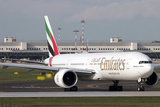 An Emirates Boeing 777 at Milano Malpensa Airport, Italy Photographic Print