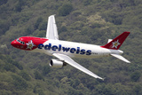 An Airbus A320 of Edelweiss Air in Flight over Locarno, Switzerland Photographic Print