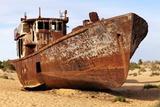 Boats in Desert around Moynaq, Muynak or Moynoq - Aral Sea or Aral Lake - Uzbekistan - Asia Print by Daniel Prudek