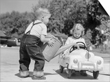1950s Little Boy Playing Gas Station Pouring Water into Toy Car for Little Girl Prints by H. Armstrong Roberts