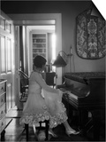 1920s Woman Pianist Sitting Playing Piano Prints by H. Armstrong Roberts