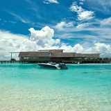 Beautiful Island Beach with Motor Boat at Maldives Photographic Print by  haveseen