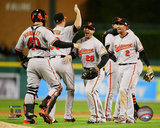 The Baltimore Orioles celebrate winning Game 3 of the 2014 American League Division Series Photo