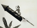 REAL Firecracker, WOMAN FLIES THROUGH AIR ASTRIDE A GIANT Firecracker, Photographic Print by Archive Holdings Inc.
