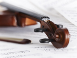 Close up of Violin, Bow and Sheet Music Photographic Print by Adam Gault