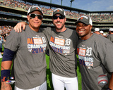 Miguel Cabrera, Justin Verlander, & Rajai Davis celebrate winning the 2014 American League Central  Photo