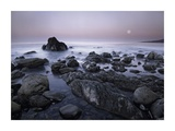 Full moon over boulders at El Pescador State Beach, Malibu, California Prints by Tim Fitzharris