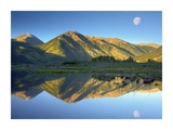 Moon and Twin Peaks reflected in lake, Colorado Prints by Tim Fitzharris