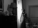Ilaria Occhini Looks Out of the Window, in the Sitting Room of Her Flat Fotografisk trykk av Marisa Rastellini
