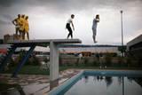 Eddy Ottoz, Mario Fusi, Sergio Ottolina and Bruno Bianchi on a Diving Board Photographic Print by Mario de Biasi