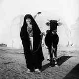 A Woman with a Bovine in Front of the Ruins of the Taq-I Kisra in Al-Mada'In Reproduction photographique par Mario de Biasi