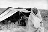 A Bedouin Family Smiling Outside a Tent Photographic Print by Mario de Biasi