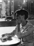 A Woman Sitting Thoughtful at the Bar of a Railway Station Fotografisk trykk av Marisa Rastellini