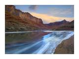 Ice on the Colorado River beneath sandstone cliffs, Cataract Canyon, Utah Print by Tim Fitzharris