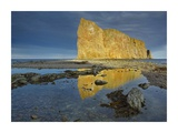 Coastline and Perce Rock, a limestone formation, Quebec, Canada Prints by Tim Fitzharris