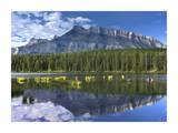 Mount Rundle and boreal forest reflected in Johnson Lake, Banff National Park, Alberta, Canada Prints by Tim Fitzharris