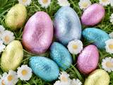 Chocolate Easter Eggs in Coloured Foil in Grass Photographic Print by  Foodfolio